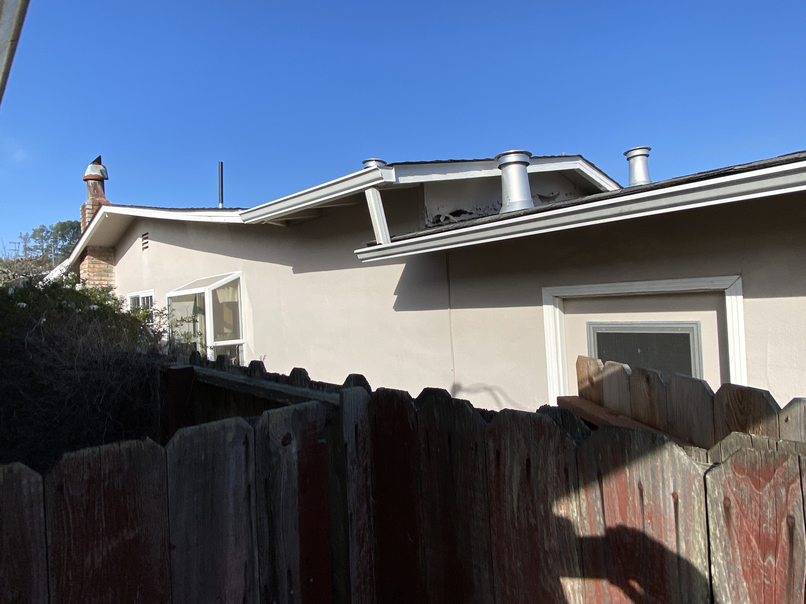 Side of house blocked by fence